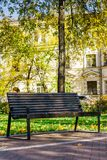 Wooden bench in a quiet city park Royalty Free Stock Image