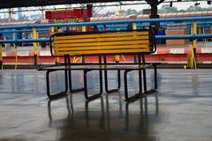Wooden bench at railway platform stock image
