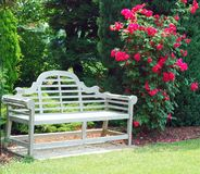Wooden Bench And Red Roses Royalty Free Stock Image