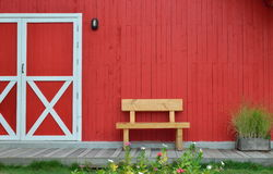 Wooden bench and red wall Stock Photo