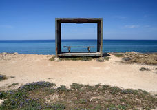 Wooden bench,relax place on the Cyprus sea coast Stock Photography