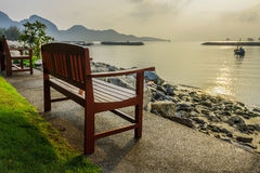 Wooden bench for relaxation at waterfront of Khlong Wan beach, T Stock Photography