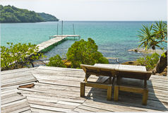 Wooden bench at resort on the coast of Kood island. Wooden bench on the coast of Kood island Royalty Free Stock Photo