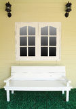 Wooden bench for rest under the window Stock Images