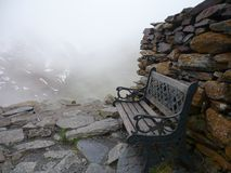 Wooden bench and resting place in high mountains.  royalty free stock photography