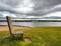 Wooden bench on a river Stock Image