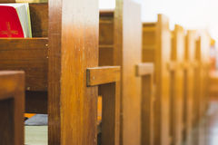 Wooden bench rows in the church Stock Images