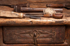 Wooden bench and rusty tools royalty free stock images