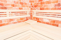 Wooden bench, salt wall and headrest support in sauna Stock Photo