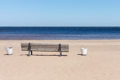 Wooden bench on the sandy beach seashore Stock Photography