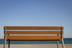 Wooden bench at the sea Stock Images