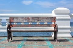Wooden bench in  the sea Royalty Free Stock Photo