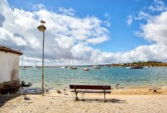 Wooden bench and seagulls. In the Portuguese town Alvor Stock Photo