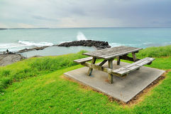 Wooden bench on a seaside hill Royalty Free Stock Image