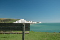 Wooden bench at Seven Sisters Stock Images