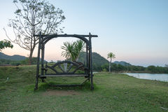Wooden bench on side of Lake,Thailand. Royalty Free Stock Images