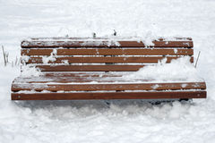 Wooden bench with snow Stock Images