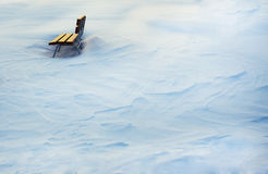 Wooden bench in snow Royalty Free Stock Photos