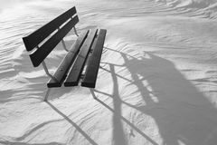 Wooden bench in snow Stock Images