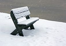 Wooden bench in  snow on  frozen  lake Royalty Free Stock Photography