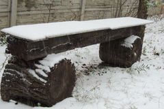 wooden bench in the snow in the garden Royalty Free Stock Image
