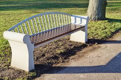 Wooden bench on a stone foundation. Stock Image