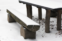 Wooden bench and table covered with snow Royalty Free Stock Photo
