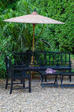 Wooden Bench and table in a pebble garden Royalty Free Stock Image