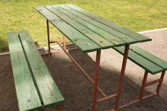 Wooden bench and table at the yard Stock Photo