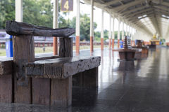 wooden bench at train station Stock Image