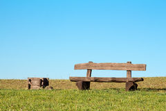 Wooden bench and trash can. In the park Royalty Free Stock Image