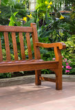 Wooden bench in the tropical garden Royalty Free Stock Image