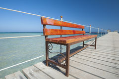 Wooden bench on tropical jetty Royalty Free Stock Images