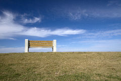 A wooden bench  under blue sky background Stock Photo
