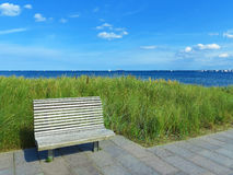 Wooden bench and view to the sea Stock Photography