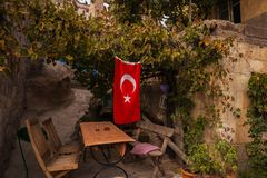 Wooden bench and a bench in a vine. Turkish flag. Uchisar. Cappadocia, Nevsehir Province, Turkey