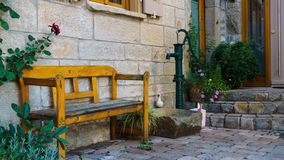 Wooden Bench. Wooden vintage Bench and a Water Pump Stock Photos