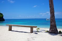 Wooden bench on a white sand tropical beach on Malapascua island, Philippines Stock Photos