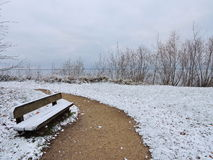 Wooden bench in winter Stock Images