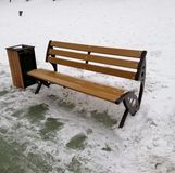 Wooden bench in the winter park royalty free stock photography