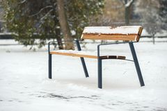 Wooden bench at winter Royalty Free Stock Photos