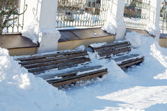 Wooden bench in winter snowdrifts Royalty Free Stock Image