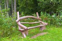 Wooden bench in the woods Royalty Free Stock Photography