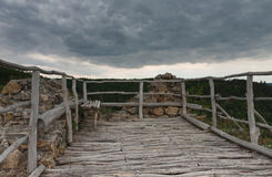 Wooden benche on castle ruins, in backgrounds is cloudy sky. Wooden bench on castle ruins, in backgrounds is cloudy sky Stock Photos