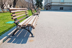 Wooden benches in the autumn park Royalty Free Stock Photo