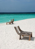 Wooden benches on beach Royalty Free Stock Photos