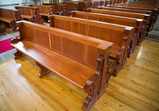 Wooden benches of church Stock Photo
