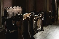 Wooden benches in the church stock photos