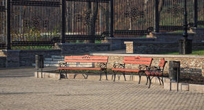 Wooden benches in a city park Stock Photo