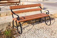 Wooden benches in the city park Stock Photography